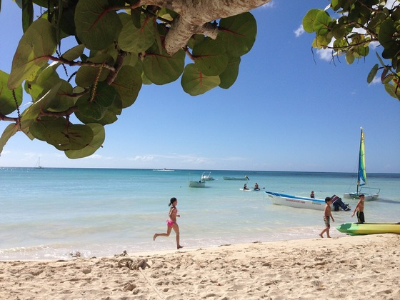 Children play on beach in the Caribbean