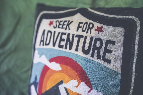 'Seek for adventure' sign on a pillow