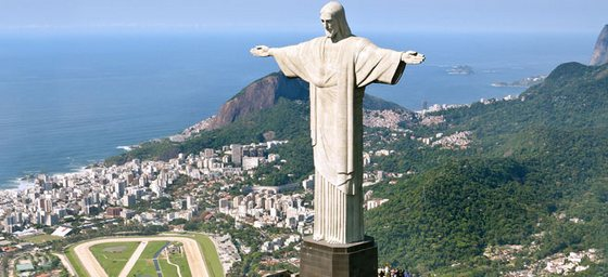 The statue of Christ the Redeemer hovers over Rio de Janeiro