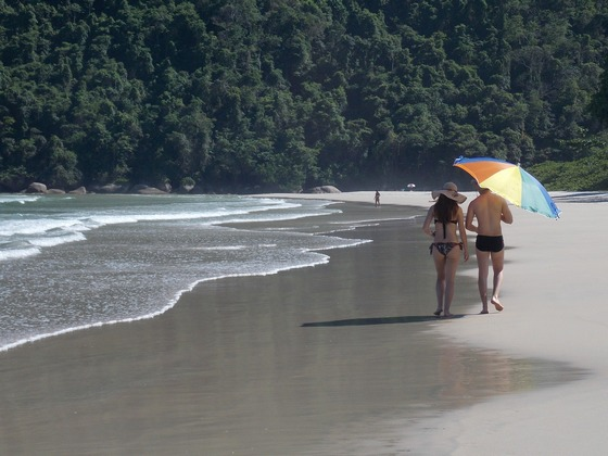 A couple walking on beach at Ilha Grande