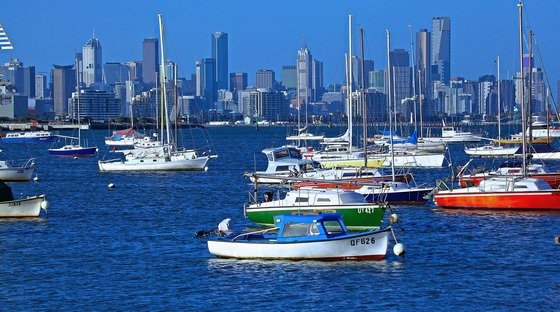 Colourful Melbourne city harbour with multiple yachts and boats