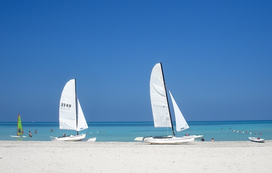 Small sailboats on a Caribbean beach