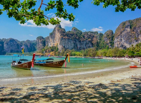 A beautiful beach in Thailand, with Thai boats