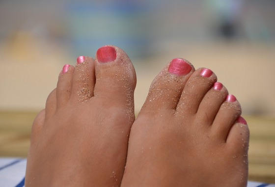 Woman's bare feet on beach