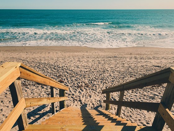 beach wooden stairs to ocean